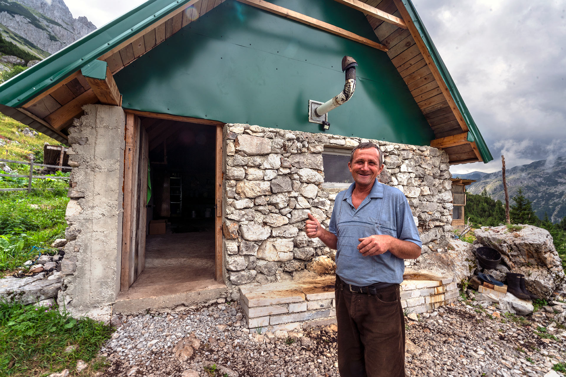 Radovan in front of his mountain home